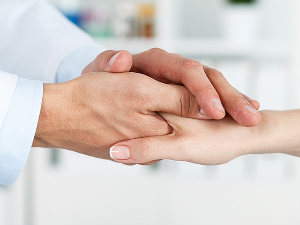 Our dentist shaking the hand of a new patient
