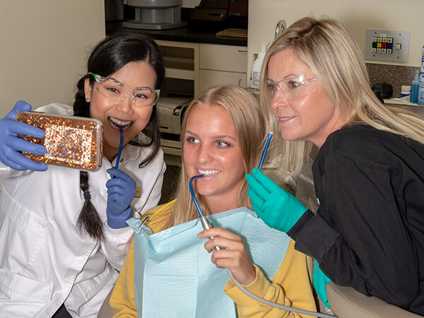 Some of our Cottage Lake Family Dentistry specialists taking a selfie with a patient