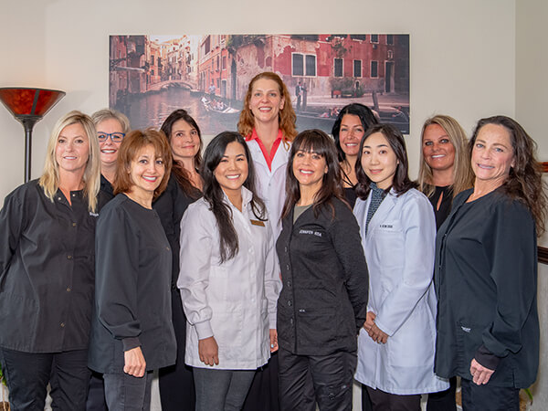 Our team in Woodinville, WA inside the dental office smiling with each other