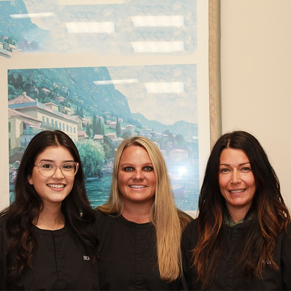 Three of our beautiful dental hygienists smiling in the office